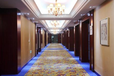 Empty hotel corridor with blue doors