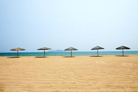 and sanya: Sunshade and chairs on beach, Sanya, China