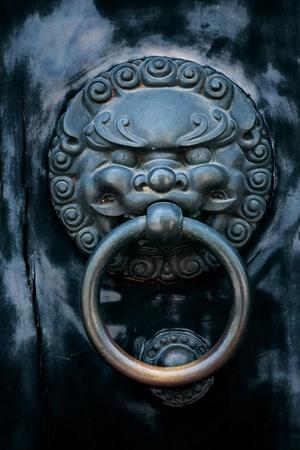 antique oriental door knocker   photo