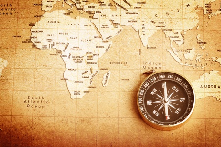 An old brass compass on a Treasure map background  Stock Photo - 13491446