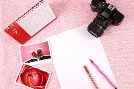 Clutter of objects stacked on pink background Stock Photo - 13494609