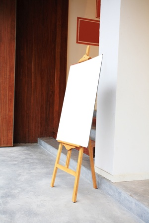 a blank painter easel in front of the studio