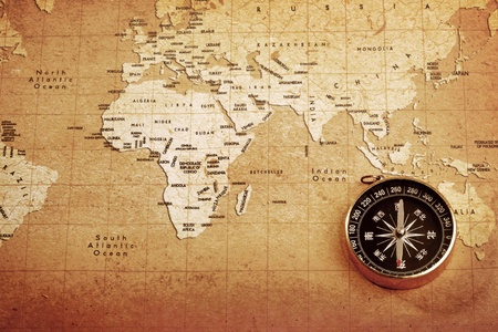 An old brass compass on a Treasure map background  photo