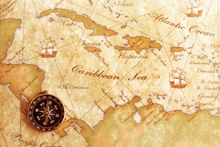 An old brass compass on a Treasure map background Stock Photo