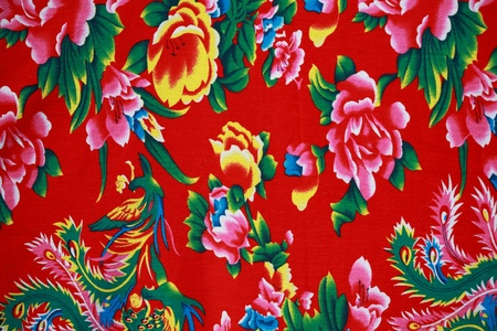 Closeup of retro tapestry fabric pattern with multi-colored floral ornament.   photo