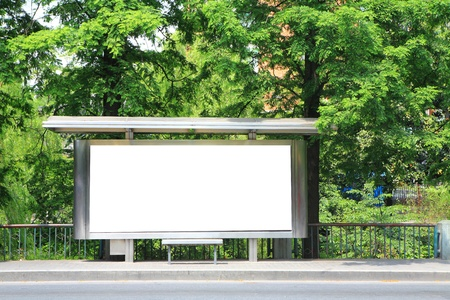 a bus stop with a blank billboard for your advertising