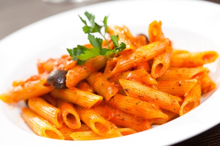 Italian pasta on white plate photo