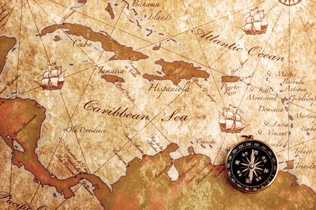 An old brass compass on a Treasure map background Stock Photo - 13591591
