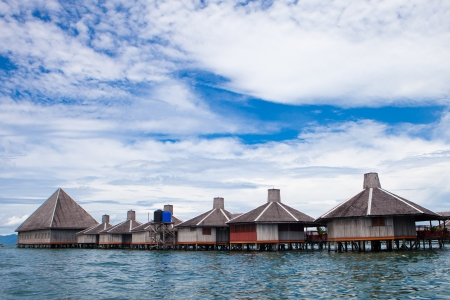Over water bungalow  with blue sky photo