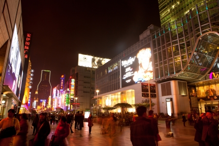 SHANGHAI - Mar. 10: night sence of Nanjing Road in the weekend in Shanghai, Mar. 10, 2012. Nanjing Road is the main shopping street of Shanghai, China, and is one of the world's busiest shopping streets. Stock Photo - 14359616