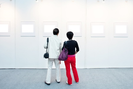 art gallery interior: empty frames in a room against a white wall