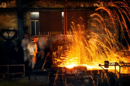 founding: Pouring of liquid metal in open hearth workshop