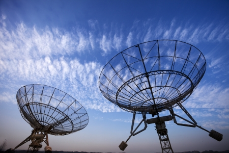 observatory: satellite dishes antenna with blue sky