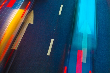 slow lane: cars in highway with blur motion
