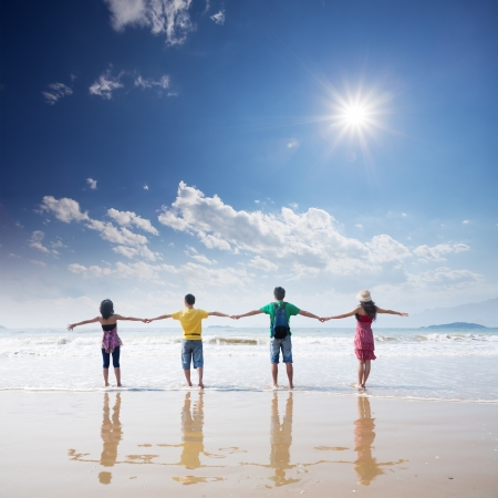 support group: friends holding togehter on beach Stock Photo