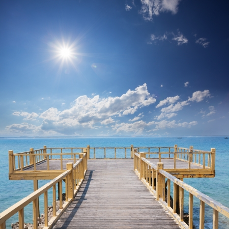 wooden platform beside beach photo