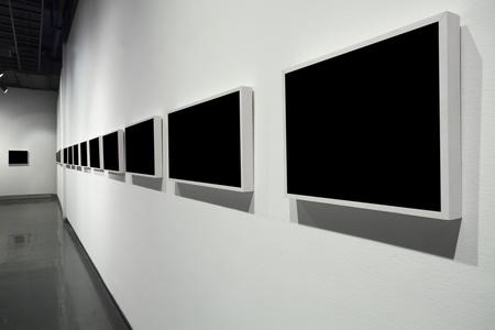gallerie: frames on white wall in art museum