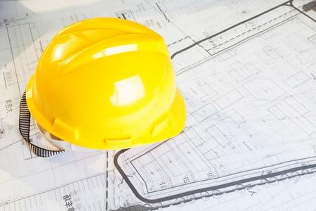 yellow helmet: Construction plans with yellow helmet