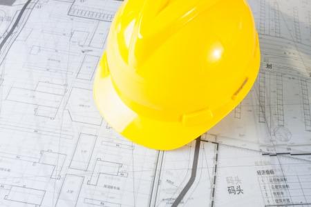 Construction plans with yellow helmet Stock Photo - 17293793