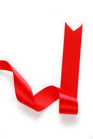 shiny background: Shiny red satin ribbon on white background Stock Photo