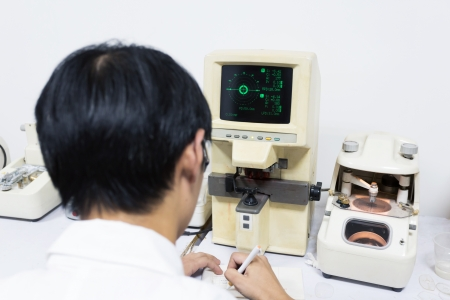 medical attendance: Medical attendance at the eye measuring  Stock Photo