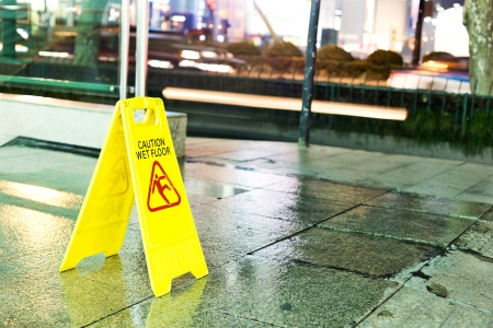 mopped: freshly mopped hallway with a caution sign in English.  Stock Photo