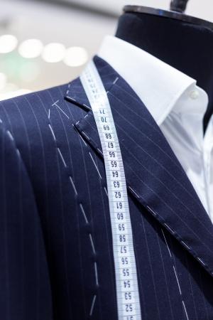 tailor: Suits on shop mannequins Stock Photo