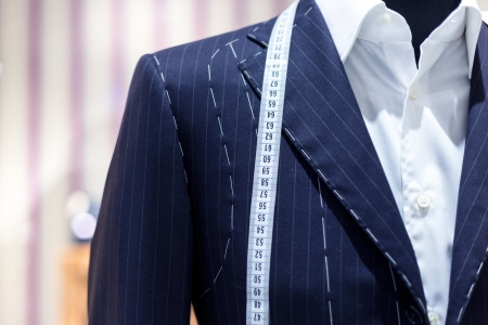 tailor suit: Suits on shop mannequins Stock Photo