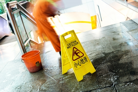 mopped: cleaning in progress, and wet floor caution sign besides.