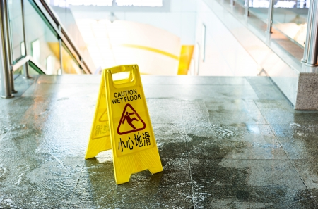 Sign showing warning of caution wet floor  photo