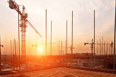 buildings under construction with sunset Stock Photo
