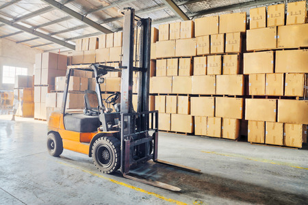warehouse cargo: Large modern warehouse with forklifts