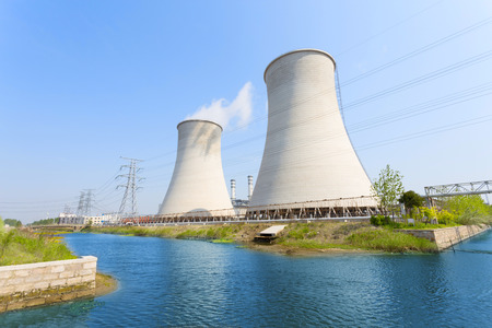 coal fired power station with cooling towers releasing steam into atmosphere  Stock Photo
