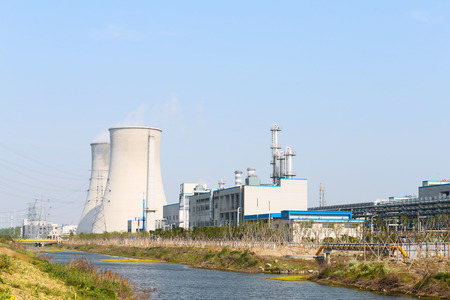 coal fired: coal fired power station with cooling towers releasing steam into atmosphere  Editorial