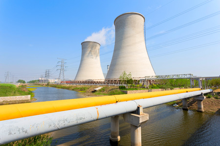 coal fired: coal fired power station with cooling towers releasing steam into atmosphere  Stock Photo