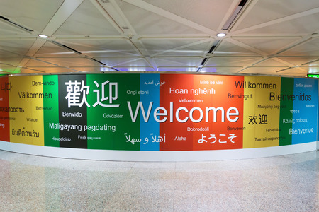 various languages of welcome in a wall Stock Photo