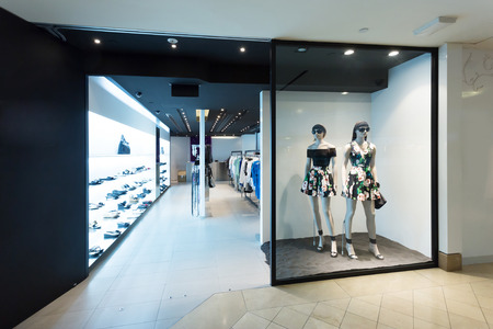 showcase interiors: clothes display in the fashion store  Editorial