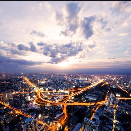 city streets: bird view of urban city traffic light trail  Stock Photo
