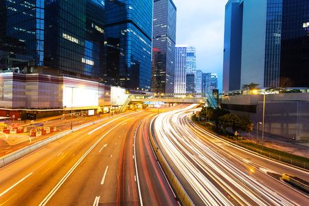 traffic building: blur motion traffic lights of modern urban city at night