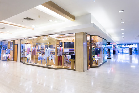 retail business: modern clothes retail shop in shopping mall Editorial