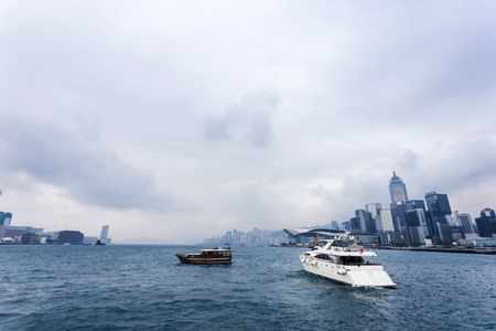 water scape: yacht, cityscape and water scape at Victoria Harbour, Hong Kong Editorial