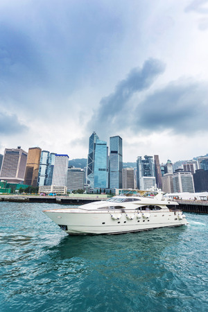water scape: yacht, cityscape and water scape at Victoria Harbour, Hong Kong Stock Photo