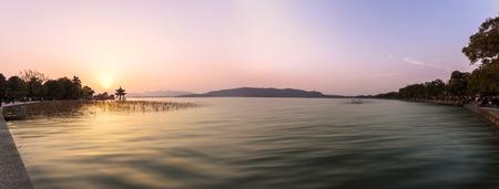 sunset city: panoramic skyline and lake at sunset in hangzhou,china