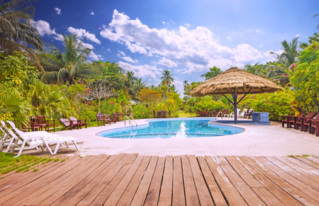 hotel exterior: Resort swimming pool with empty plank board
