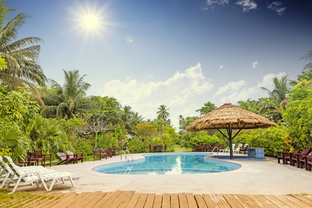 beautiful garden: Resort swimming pool with empty plank board