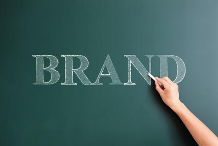 writing brand on blackboard photo