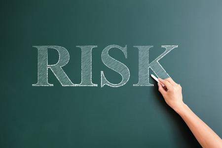 risk written on blackboard photo