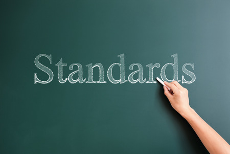 standards: standards written on blackboard Stock Photo