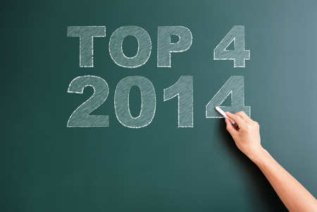 title hands: top 4 2014 written on blackboard