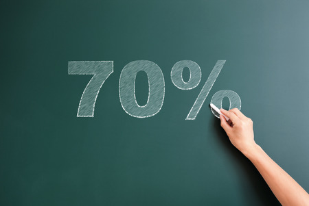 70: writing 70% on blackboard Stock Photo